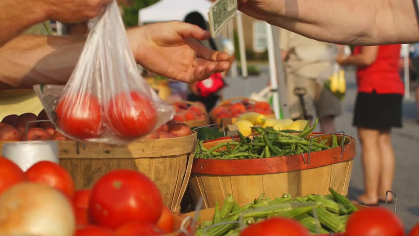 Food being purchased at Farmer's Market.