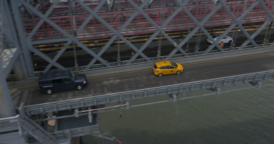 Aerial Tracking Shot of a Yellow Taxi Cab on the Brooklyn Bridge ( New York City- July 2015) | Shutterstock HD Video #13397990