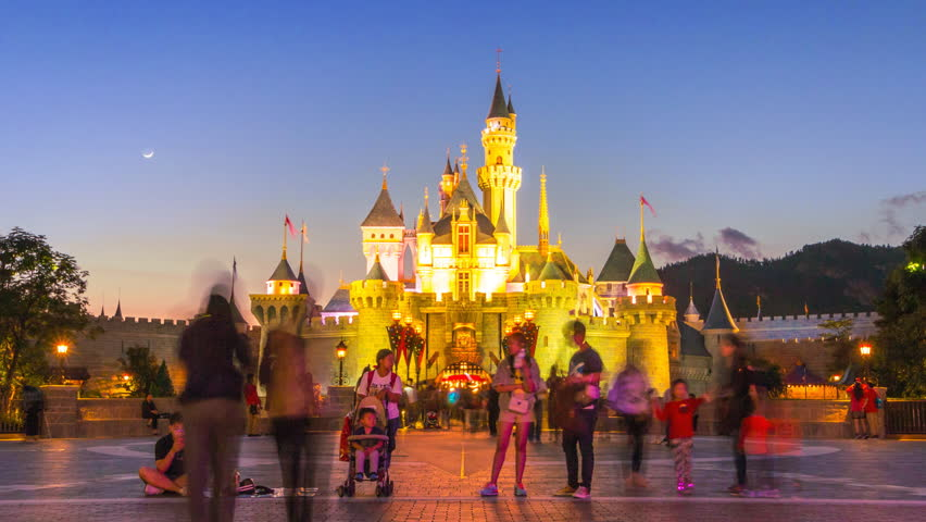 HONG KONG - NOVEMBER 24 : Time Lapse Disneyland Castle And Many People Wait For Night Parade Show Of Hong Kong Disneyland, Hong Kong 2014