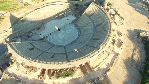 Aerial Israel. Spinning around Caesarea Amphitheater showing it from all the sides with archeological sites around