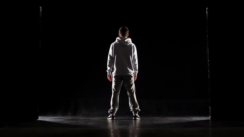 db7d5203e3f hd00 25Young Man in hoodie on a black background. Studio ...