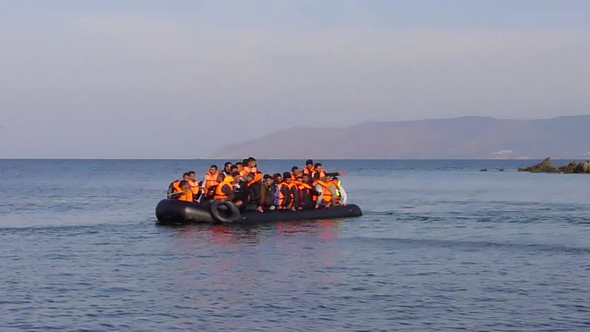 LESVOS, GREECE October 19, 2015: Refugees arriving in Greece in dinghy boat from Turkey. These Syrian, Afghanistan and African refugees land their boat at the North coast of Lesvos near Molyvos.