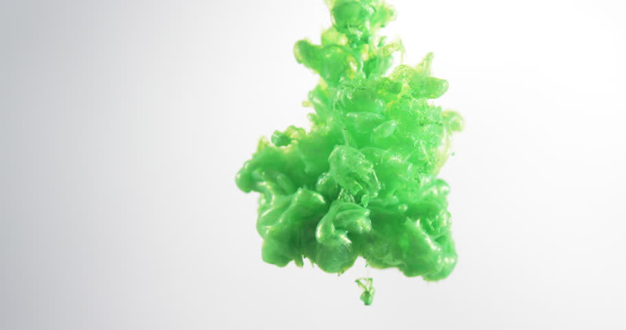 Green Ink Droplets / Paint / Slime in slow motion isolated on white