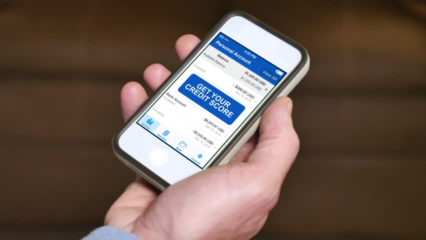 A man checks his FICO credit score on his smartphone. The result is good. Fictional device and screen interface.
