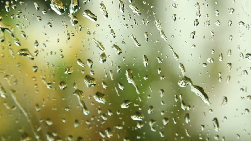 Close up image of rain drops falling on a window with sound of rain and wind | Shutterstock HD Video #1355530
