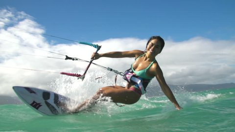 Asian Woman Kite Surfing In Ocean, Extreme Summer Sport