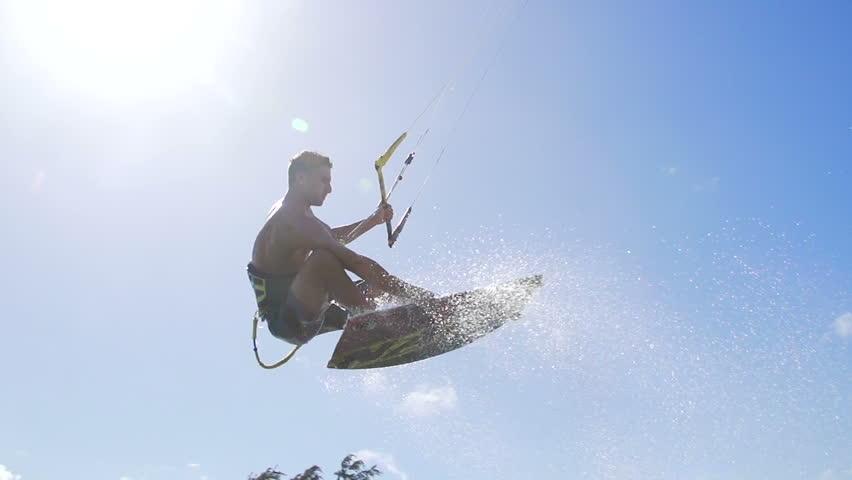 Man Kite Surfing In Ocean on Summer Day, Extreme Sport