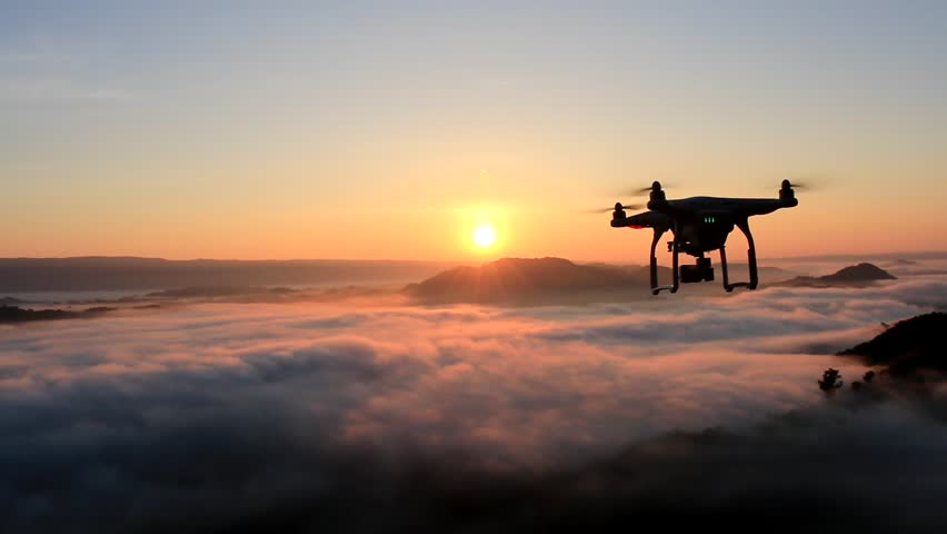 drone flying over cloud in morning, in a aerial shot,