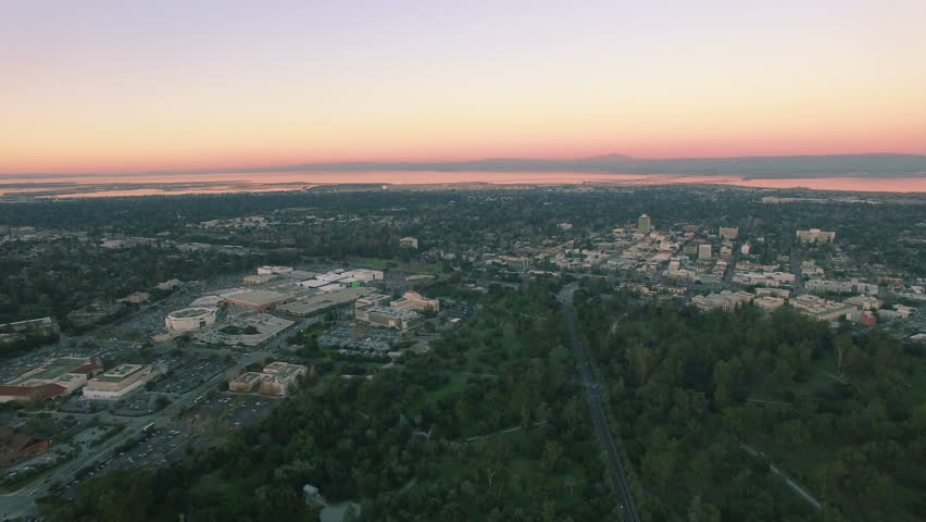 4K Aerial Drone Shot Stanford University Above Forest Ocean Sunset