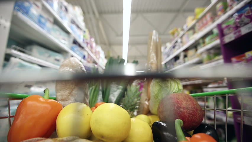 Full shopping cart with healthy food moving through aisles of supermarket. Time lapse | Shutterstock HD Video #13714361
