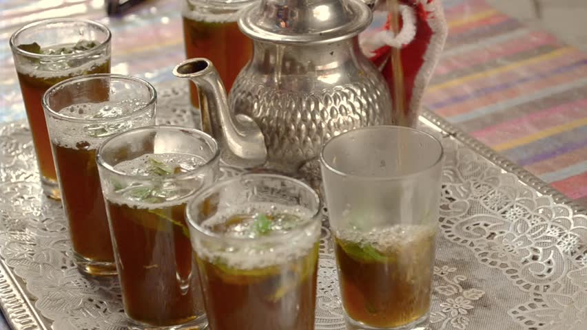 man serving traditional Moroccan tea