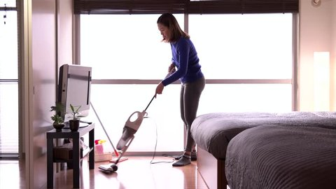 Asian housemaid cleaning hotel room, young woman job, people working. Chinese girl in resort, staff at work as maid, professional occupation. Housekeeper wiping floor with vacuum cleaner at home