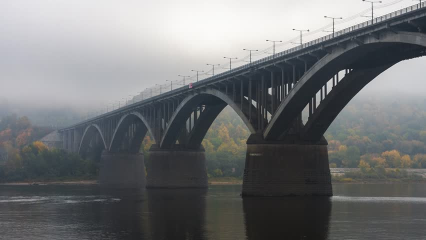 Time-lapse of the bridge and river in the fog.  #13785113