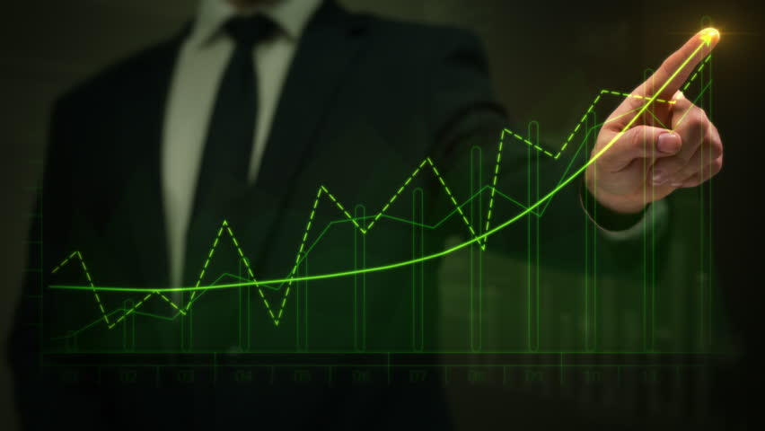Businessman drawing an ascending financial chart. Touchscreen. Green and Red. 2 colors in 1 file. Businessman drawing a bright arrow showing increasing profits in a financial chart. Business success.