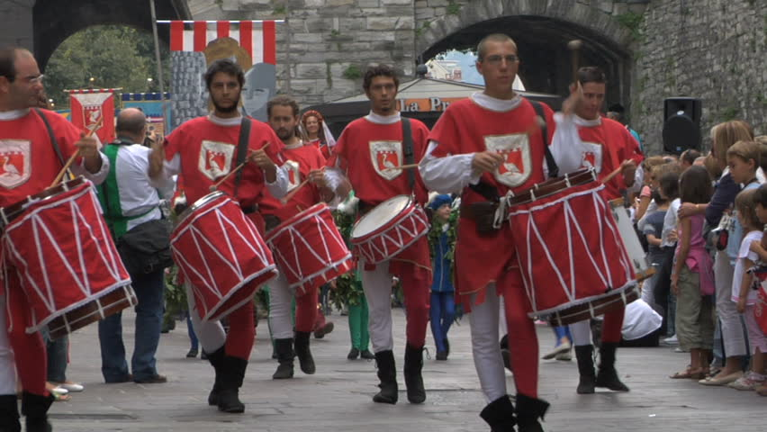 Como, Italy - September 2011: Palio del Baradello. Drummers and flag twirlers dressed in traditional medieval costumes,