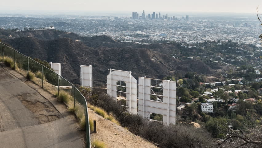 LOS ANGELES, CALIFORNIA, USA - December 20, 2015:  Zooming time lapse of weekend tourists viewing the back of the Hollywood Sign in Griffith Park.   | Shutterstock HD Video #13811090