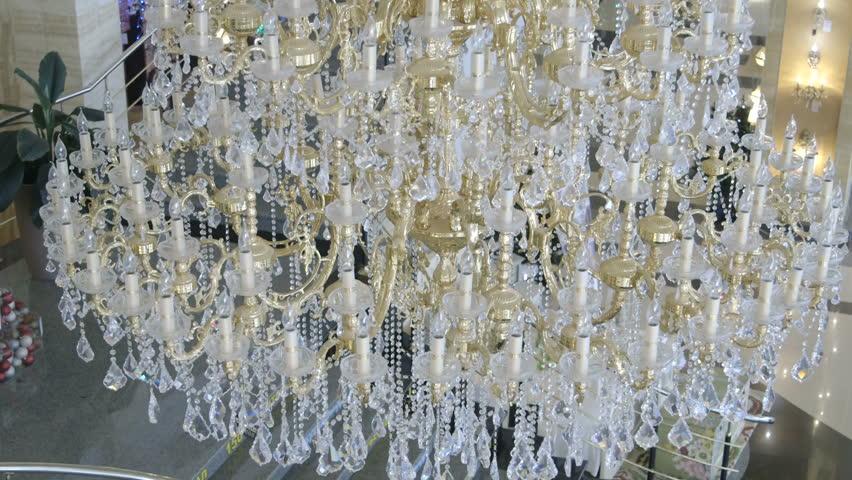 Ceiling Crystal Chandelier In Lighting Store Showroom Pan Shot ...