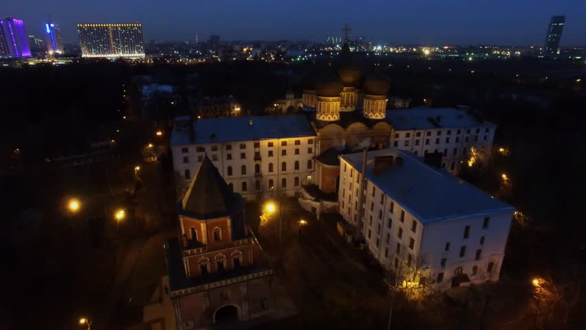 MOSCOW - NOV 22, 2015: Cathedral of Holy Virgin on Izmailovsky island and megalopolis with illumination at autumn evening. Aerial view #13840010
