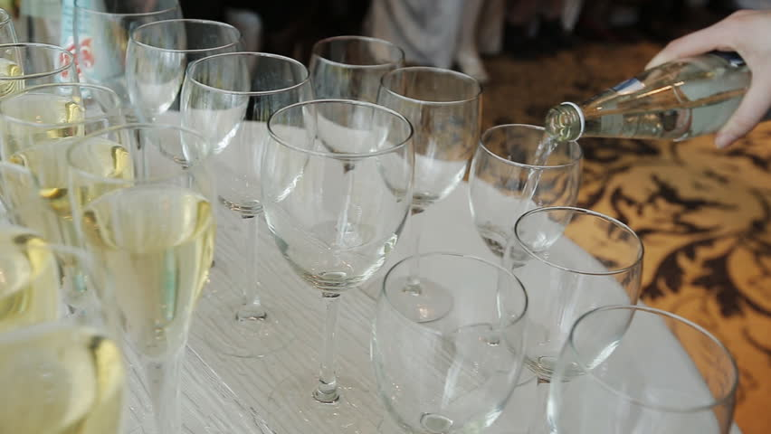 The waiter pours champagne into glasses | Shutterstock HD Video #13867940