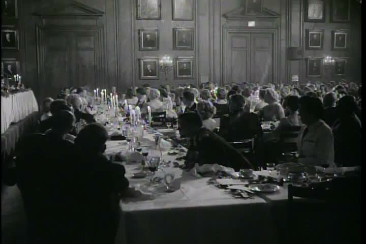 CIRCA 1960s - A Canadian colonel gives a speech about the 111th regiment at a distinguished ceremonial party in the 1960s.
