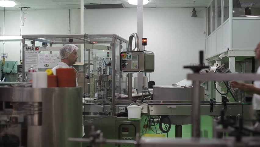 ISRAEL - CIRCA JUNE 2015 -2 technicians advise each other at factory production line next to machines   Shutterstock HD Video #13876340