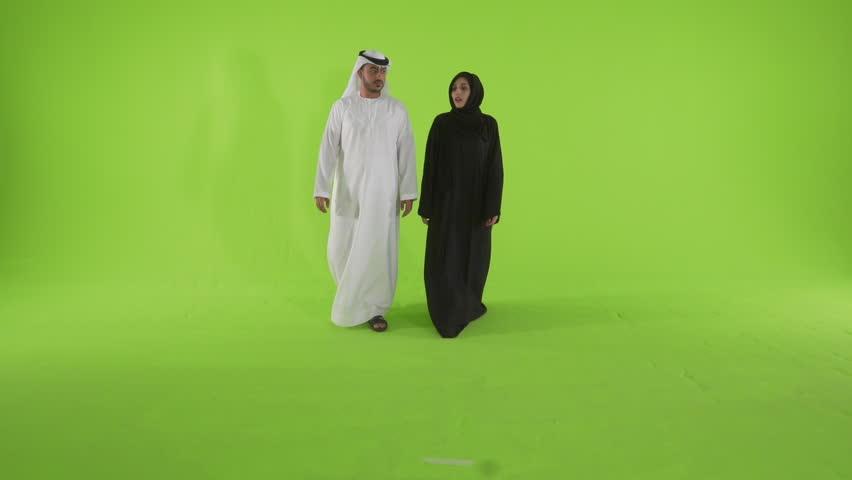 Emirati couple looking with curiosity. Dubai, UAE -- July 2015