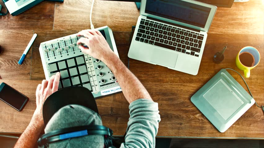 Cinemagram / Cinemagraph: Music Producer / DJ working with his Drum Machine / mixer on old wood table, desktop - overhead top shot | Shutterstock HD Video #13898435
