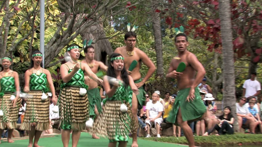Polynesian Cultural Center, Oahu, Hawaii. Students from Brigham Young University putting on shows and demonstrations. Boat or canoe representing New Zealand culture with dancers. Editorial use.