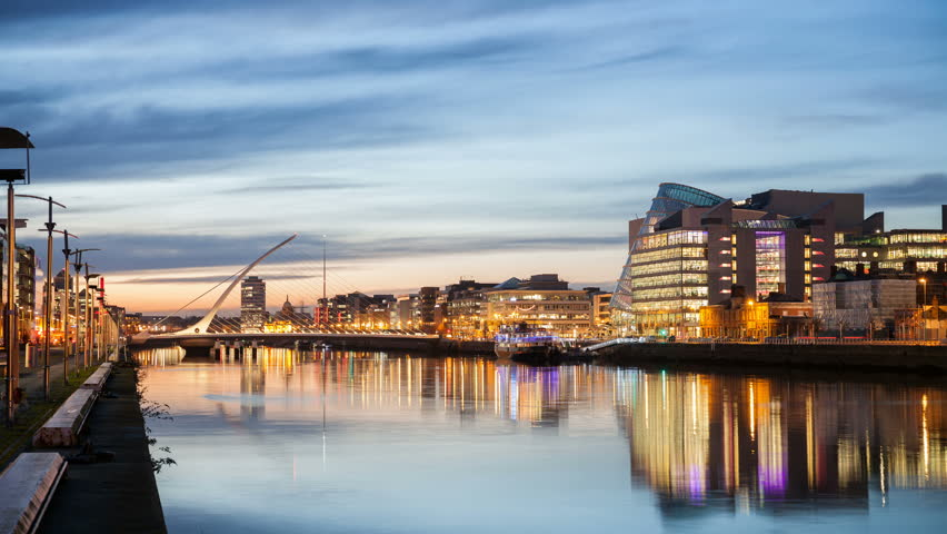 HD time laps video of the City centre and river Liffey with Samuel Beckett Bridge during sunset. Dublin, Ireland #13932425