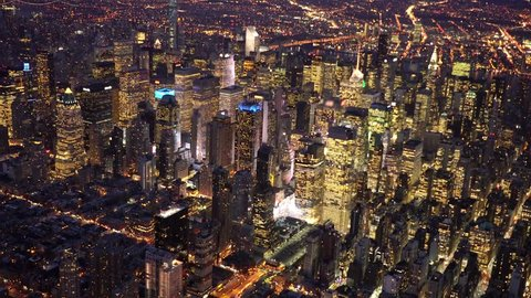 aerial view of illuminated city metropolis at night. new york city high rise real estate buildings background