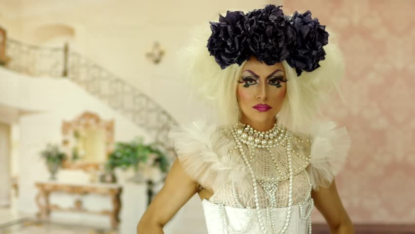 Drag queen with a glamorous and spectacular look doing some great acting and interacting for camera #13956380