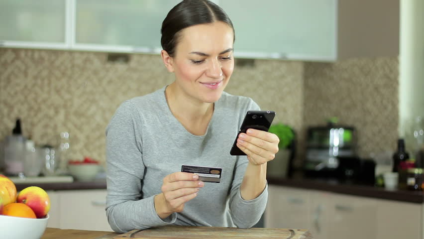 Young Woman Using Her Mobile Phone In The Kitchen At Home Stock ...