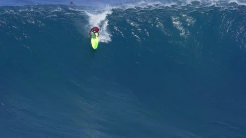 MAUI, HAWAII. January, 15 2016: Big Wave Surfing at Jaws. Surfer Rides Giant Ocean Waves.