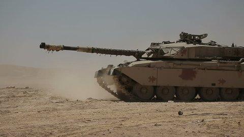 Tank M1 Abrams rides in the desert. 2 shot.