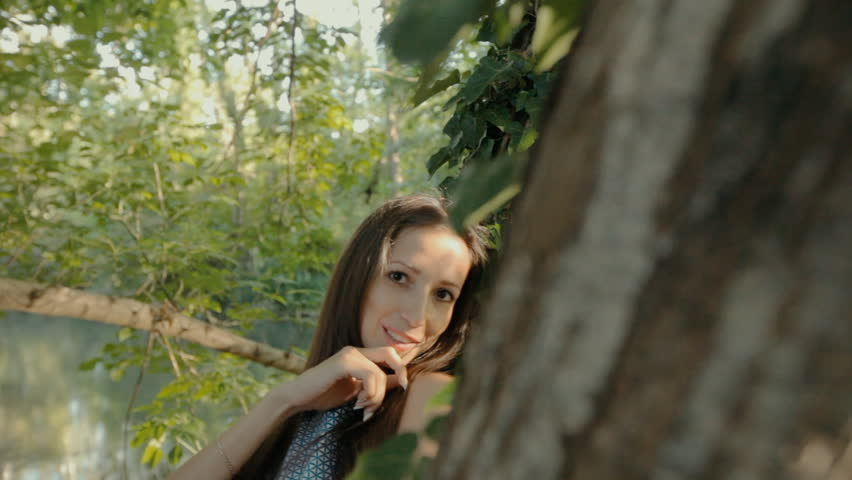 Beautiful girl in a dress stands near the tree in the forest   Shutterstock HD Video #14043830
