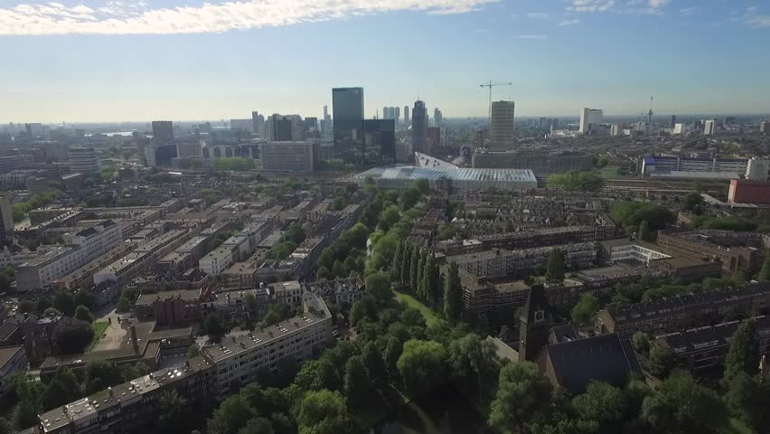 Aerial footage from Rotterdam, showing the city skyline and new Central Station while flying over a suburban area. | Shutterstock HD Video #14044670