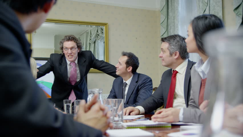 4k / Ultra HD version Happy and enthusiastic business team of mixed ages and ethnicity are seated around a conference table for a business meeting. In slow motion. Shot on RED Epic | Shutterstock HD Video #14048684