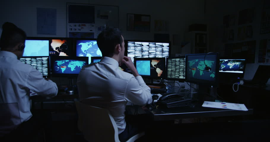 4k / Ultra HD version A team of male security personnel are manning the stations within a busy system control room. This could be a weather station or airport traffic control room. In slow motion.  | Shutterstock HD Video #14051000