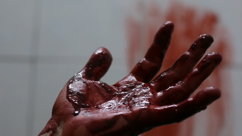 Closeup shot of Murderer's shows bloody hands