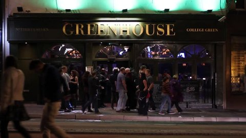 "BRISTOL - August 15: Busy British Pub Exterior, the ""Green House"" on August 15th 2015 in Bristol England."