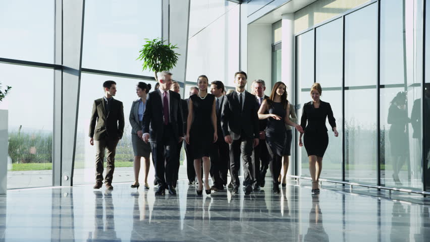 4k / Ultra HD version Portrait of an attractive multi-racial business team, as they walk through a light and modern glass fronted office building towards the camera. In slow motion. Shot on RED Epic | Shutterstock HD Video #14126663