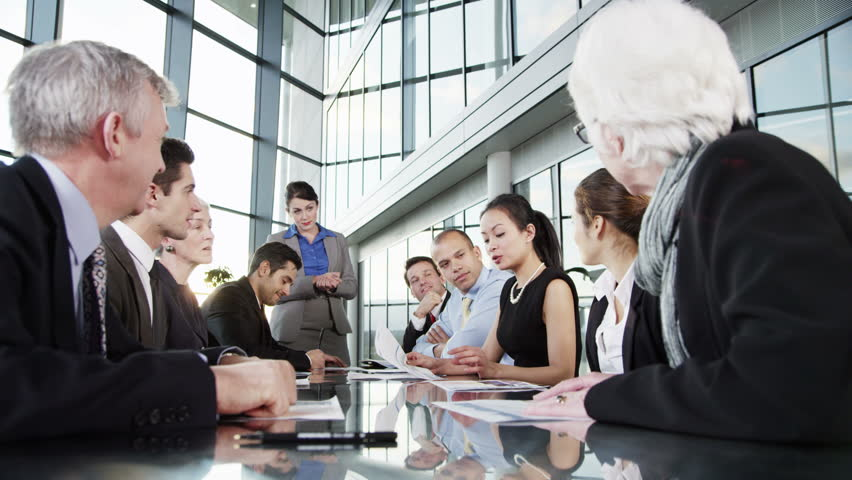 4k / Ultra HD version A confident and happy business team are holding a meeting in a modern office building. They are discussing ideas, applauding a comment from one of the group. Shot on RED Epic | Shutterstock HD Video #14127410