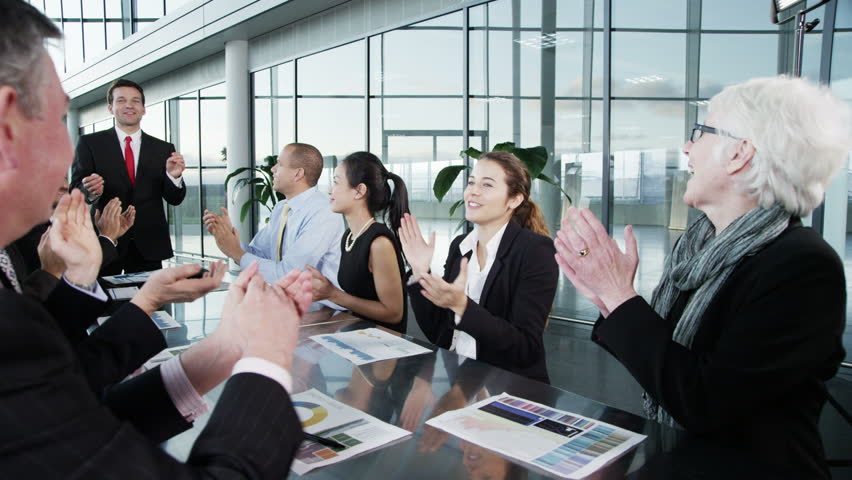 4k / Ultra HD version A confident and happy business team are holding a meeting in a light, modern office building. They are discussing ideas for their business development. Shot on RED Epic | Shutterstock HD Video #14127680
