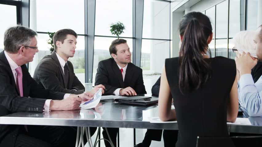 4k / Ultra HD version Cheerful diverse business group in discussion in a business meeting. Shot on RED Epic | Shutterstock HD Video #14128070