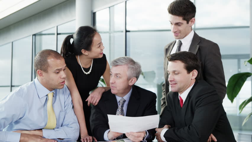 4k / Ultra HD version Cheerful diverse business group in discussion in a business meeting. Shot on RED Epic | Shutterstock HD Video #14128115