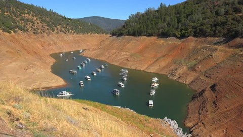 OROVILLE LAKE, CALIFORNIA - CIRCA 2015 - Houseboats sit in low water at Oroville Lake in California during extreme drought.
