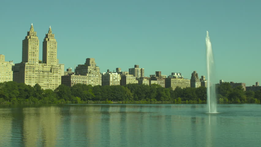 New York, NY - August, 2011: Stationary establishing shot of Central Park with view of apartments on Central Park West and lake. New York City. Day. | Shutterstock HD Video #14165000