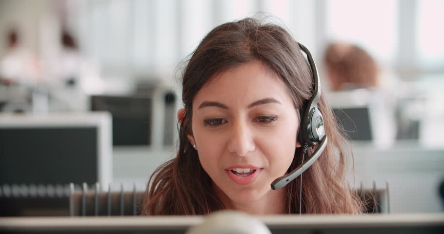 Young woman working in a call center using a headset #14171060