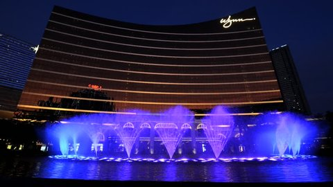 MACAU, CHINA - SEPTEMBER 14, 2013: View to the show of the dancing fountains in front of the Wynn hotel in Macau, China.