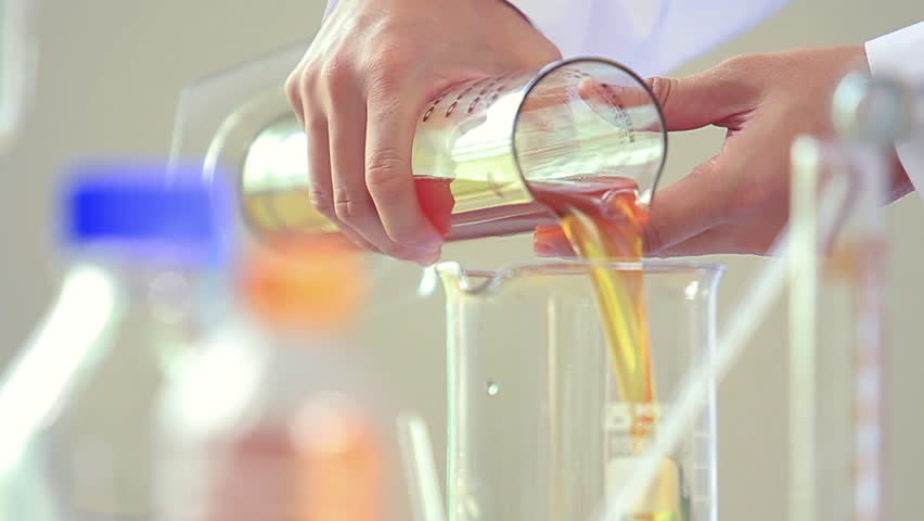 Chemical test in laboratory,Scientist performing chemical liquid test in laboratory.